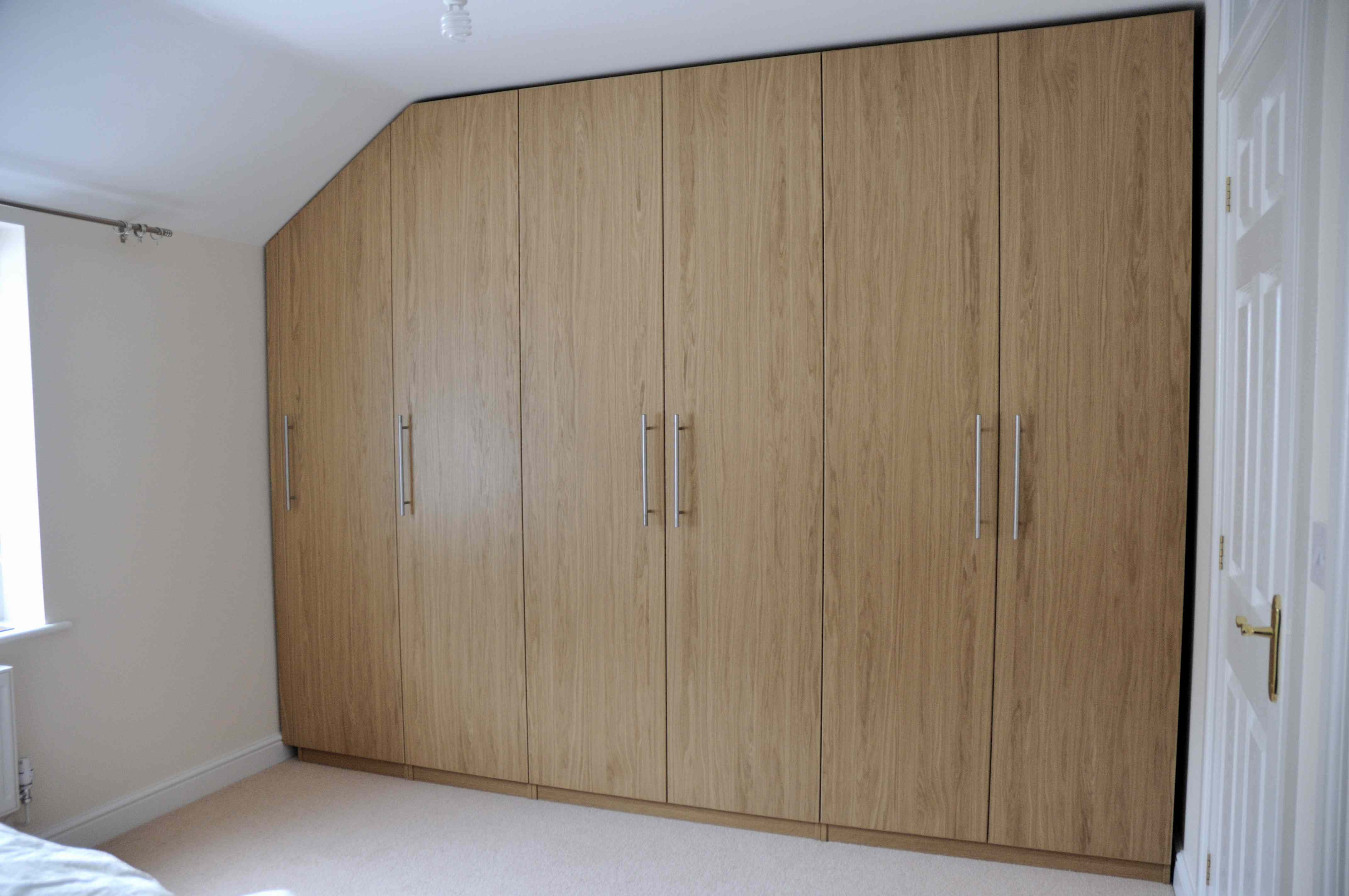fitted-furniture-ikea-wardrobes-fitted-into-awkward-alcove-1