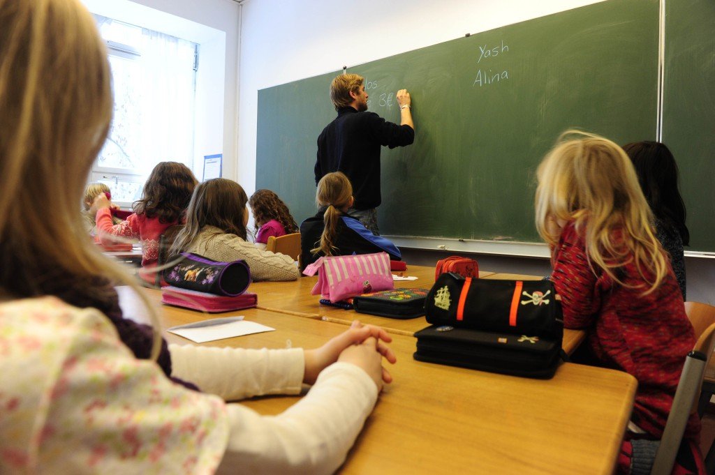 A teacher writes on the blackboard during class in a primary school in Berlin December 7, 2010. The three-yearly OECD Programme for International Student Assessment (PISA) report, which compares the knowledge and skills of 15-year-olds in 70 countries around the world, ranked Germany in the middle field for reading skills and above the OECD-average for mathematics and natural sciences. Teenagers from the Chinese city of Shanghai have the best education in the world, according to the major international study. AFP PHOTO / JOHN MACDOUGALL (Photo credit should read JOHN MACDOUGALL/AFP/Getty Images)